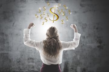 woman celebrating with symbols of money or dollars