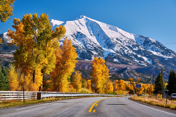 Highway in Colorado Rocky Mountains at autumn