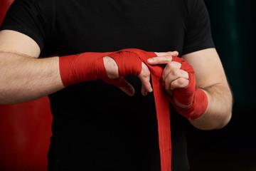 Close-up of applying boxing bandage