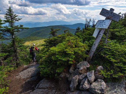 Hiker on Appalachian Trail in Maine, Lush Mountain Vista, Wooden Trail Sign