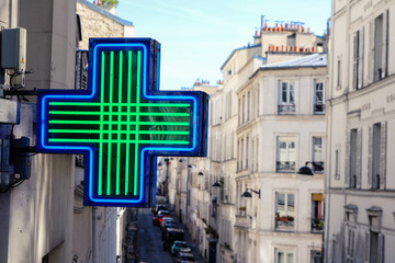 Photo sur Plexiglas Pharmacie Medical cross of pharmacy in Paris Montmartre