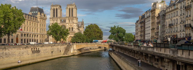 View along the Seine River in Paris looking toward Notre Dame Cathedral.