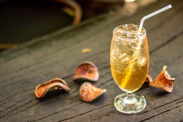 Door stickers Condiments Bael herbal juice with Thai herbal ice put on wooden floor. Eat freshly.