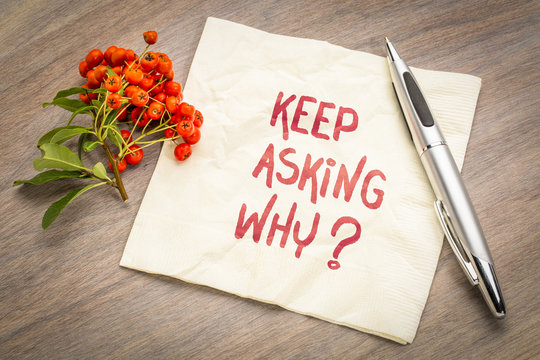 Keep asking why? Inspirational handwriting on a napkin