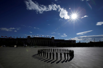 A military band practises at Tiananmen Square for a tribute ceremony in front of the Monument to the People's Heroes in Beijing
