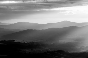 Sunrays coming over a valley in Umbria (Italy)