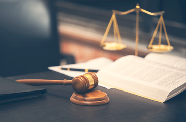 judge gavel with law book on wooden table