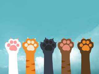 Cat paw cartoon on blue sky and cloud background