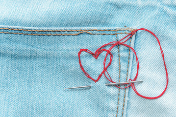 red hearts on jeans trousers