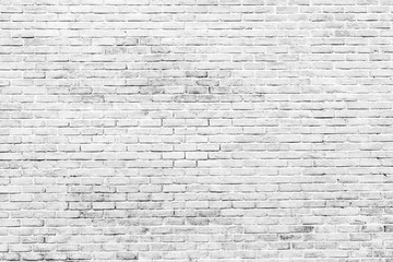 White and grey brick wall texture background with space for text. White bricks wallpaper. Home...