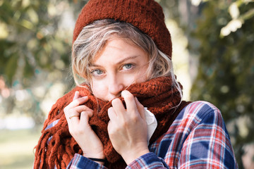 Young woman wearing woolen cap and scarf outdoor