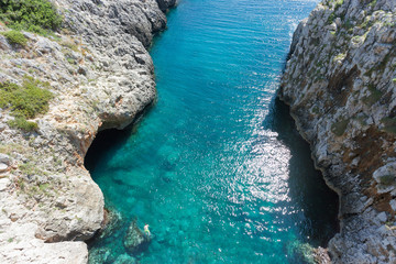 Apulia, Leuca, Grotto of Ciolo - A man swimming at Grotto Ciolo