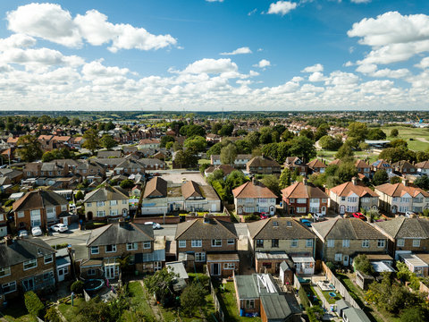 Aerial view of suburban houses in Ipswich, UK. View from backyard. Nice sunny day.