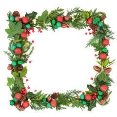 Abstract Christmas and winter square wreath garland with fir leaf sprigs, holly berries, ivy, mistletoe, bauble decorations, laurel, pine cones and acorns on white background with copy space.