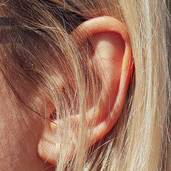 Ear on the head of a woman