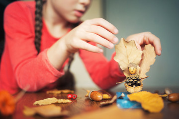 autumn craft with kids. children's cute boat with man made of natural materials. process of creating Wall mural