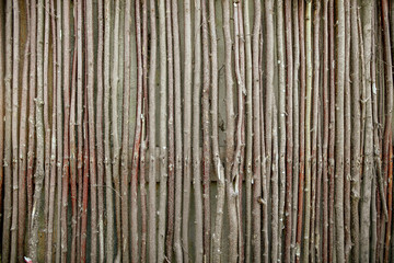 Fence of wooden branches as a background