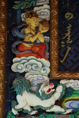Exterior wood carving and painting, buddhist and religious decoration and art of tibetian monastery and meditation center at Terelji National Park, Mongolia, Asi