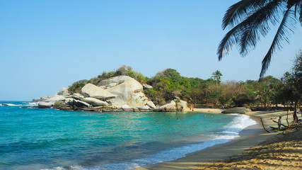 tropical beach with turquoise water at tayrona natural park