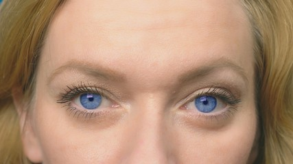 Stock Video of Beautiful blue eyes close-up  A young woman