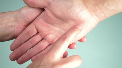 Close up. human hand and psychic or fortune, teller explain lines on palm. Palmistry concept. color background
