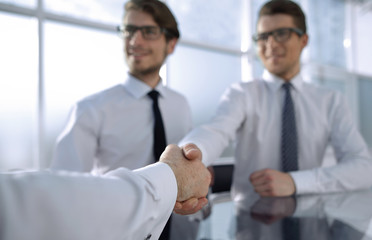 background image of a handshake of business people