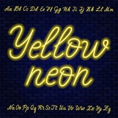 Fototapete - Yellow neon script. Uppercase and lowercase letters.