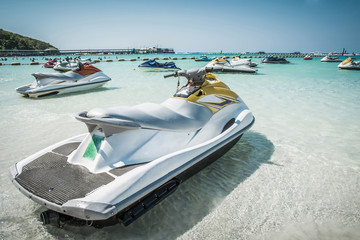 A jet ski on the beach with a sea background