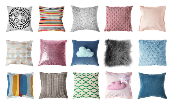Set with decorative pillows on white background