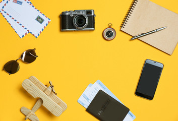 Flat lay composition with camera, passport and space for text on color background. Professional photography