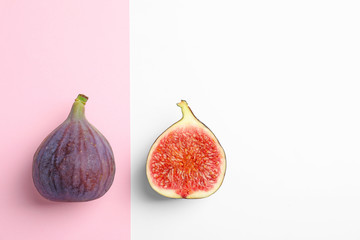 Fresh ripe figs on color background, top view. Space for text