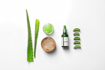 Flat lay composition with aloe vera on white background