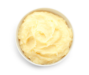 Bowl with mashed potatoes on white background, top view