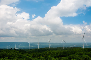 Wind turbines on mountain with blue sky and cloud,Wind power station. Ecological energy composition