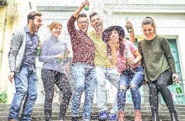Group of happy friends making party on a urban area - Young people having fun laughing together and drinking beers outdoor - Friendship, celebration, youth lifestyle concept
