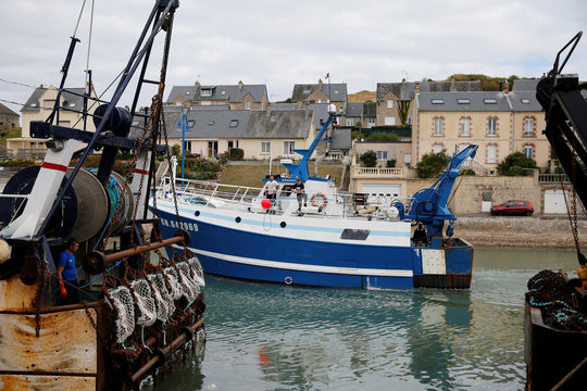The French trawler No Comment is seen as it leaves the harbour of Port-en-Bessin on the eve of the start of the scallop fishing season