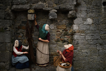 Actors participate in a street performance called 'The Fisherwives', by Bru Theatre group, representing part of the fishing community from 100 years ago, at the Spanish Arch in Galway