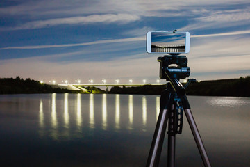 Using smartphone like professional camera on tripod to capturing night landscape