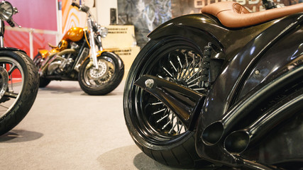 The rear wheel of a motorcycle. A rear view of a motorcycle