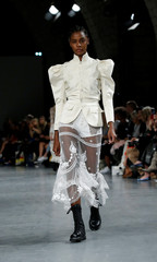 A model presents a creation by designer Bill Gaytten as part of his Spring/Summer 2019 women's ready-to-wear collection show for John Galliano during Paris Fashion Week in Paris