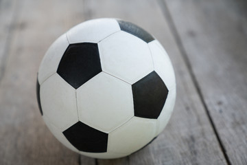 Soccer ball on old wooden floor, Copy space