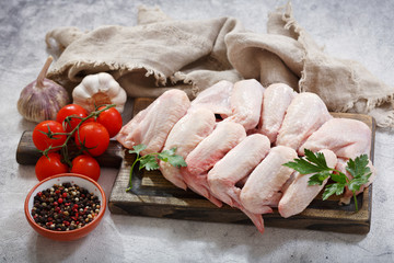 fresh chicken wings with ingredients for cooking