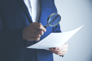 man hand document with magnifier