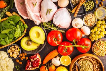 Balanced diet food background. Healthy ingredients on a dark background, top view.