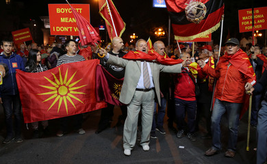 Protesters shout out slogans about boycotting the referendum on changing the country's name that would open the way for it to join NATO and the European Union in Skopje