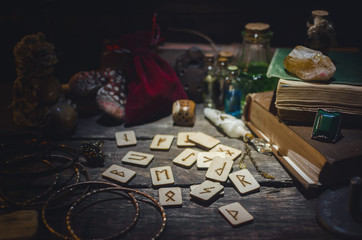 Runes for divination on fortune teller desk table background. Futune reading concept.