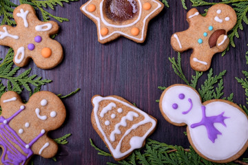 Assortment of Christmas cookies decorated with multicoloured glazing framing copy space in the middle