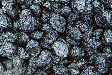 Background of black raisins, dried grapes