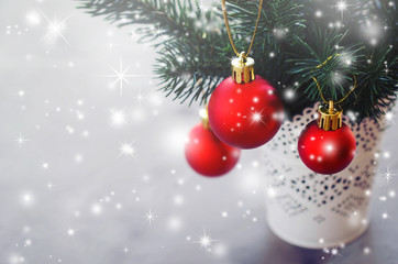 Christmas background with xmas fir branches and decorations. Christmas greeting postcard.