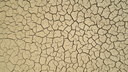 Aerial view of Dry cracked earth. Climate change and drought land. Global warming.